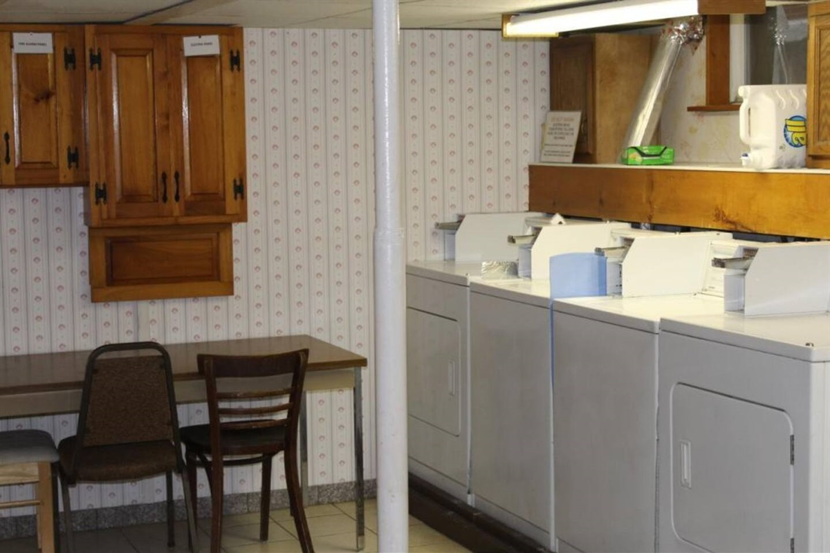 Shared laundry room with multiple washers and dryers - no waiting!