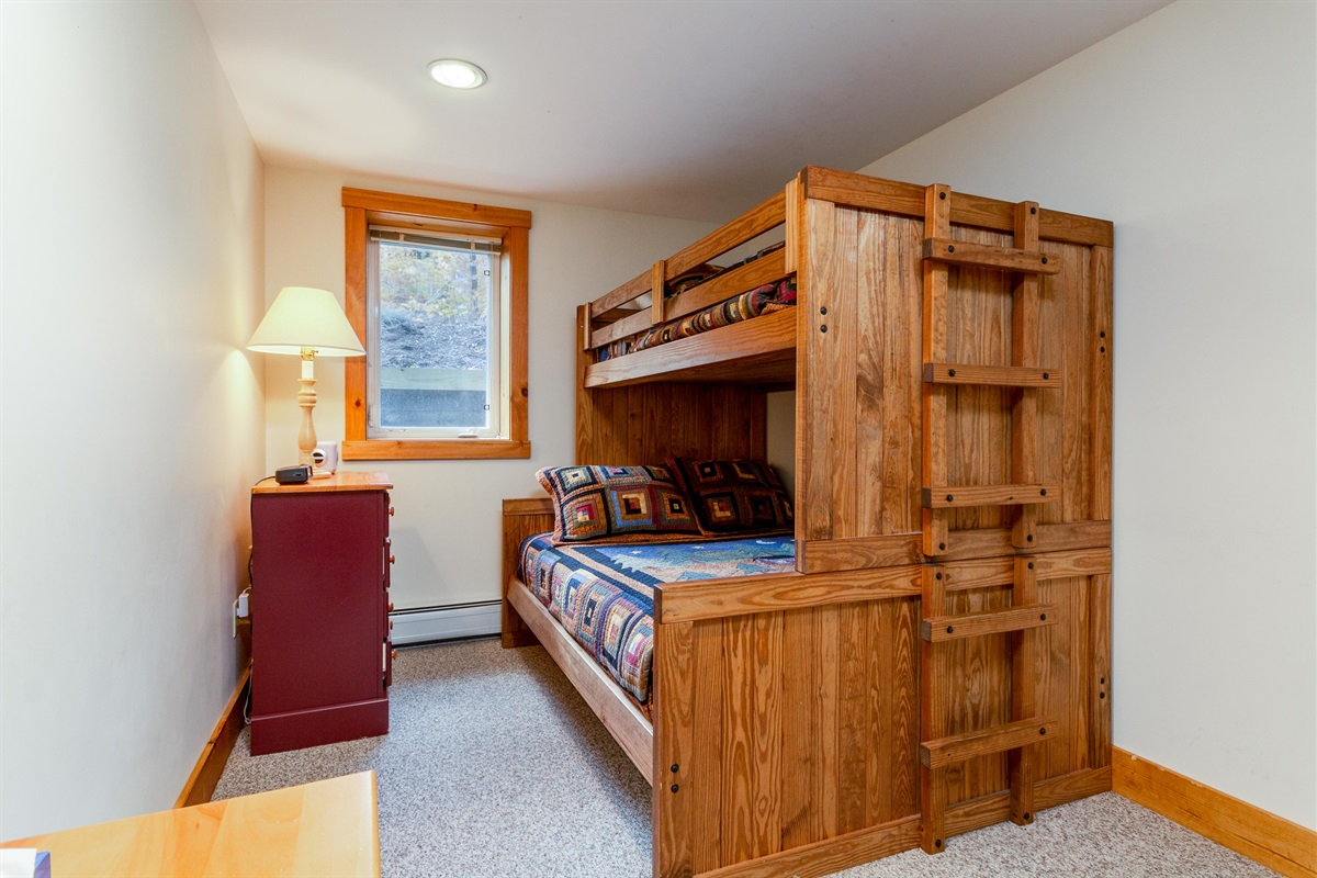 Second bedroom, double bed with twin on top. Sturdy beds, fine for adults.
