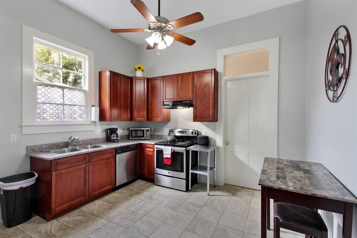 Full kitchen. Electric range, dishwasher, microwave, toaster, pots, pans, dishes, etc.
