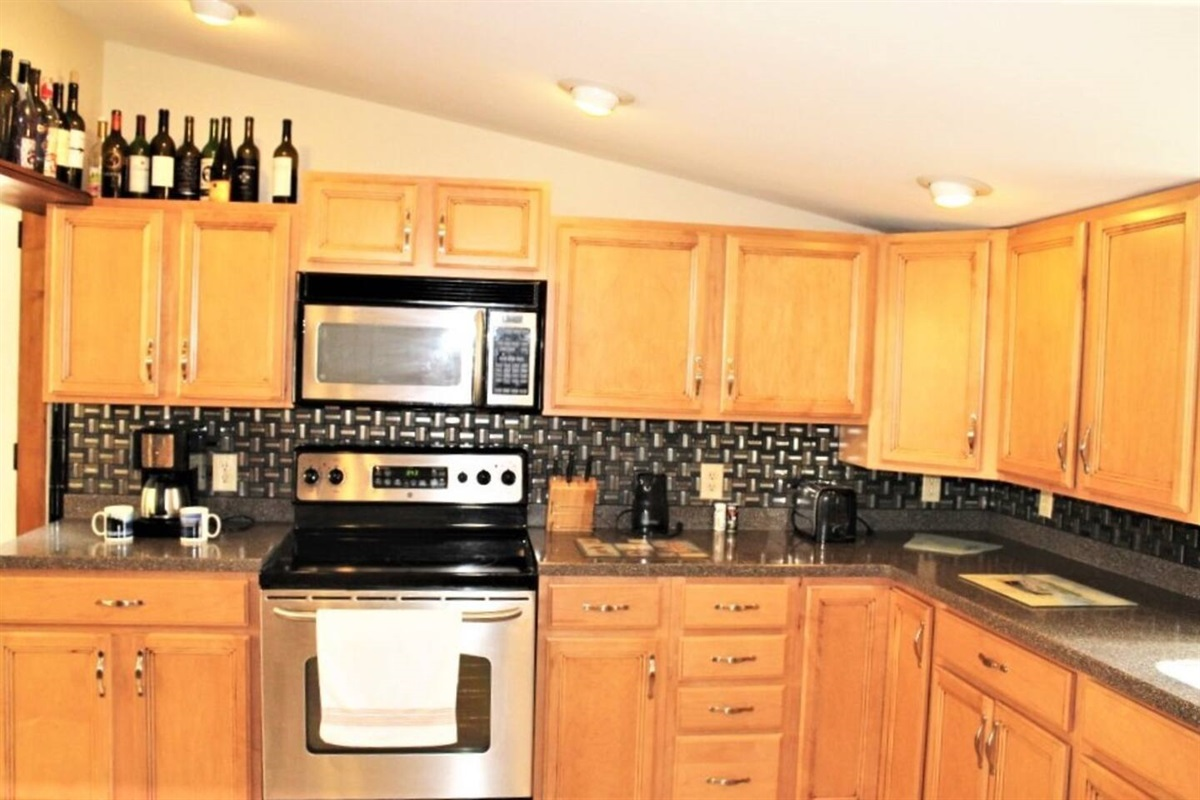 Stainless steel appliances with over the range microwave, dishwasher, and refrigerator with automatic ice maker