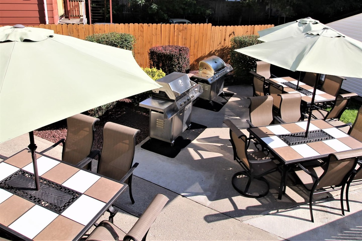 Back patio with gas grills and patio sets for outdoor dining (shared area)
