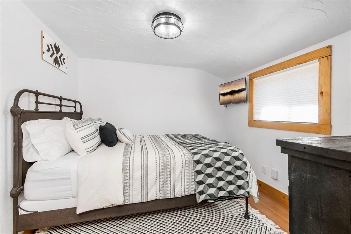 Bedroom #2 (Upper Level): This bedroom has TV, dresser, and 1 queen bed.