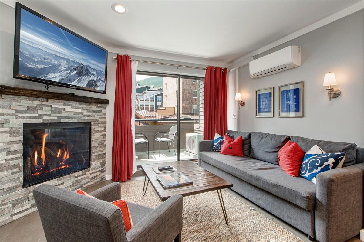 Living area - gas fireplace, flatscreen TV, deck, sleeper sofa
