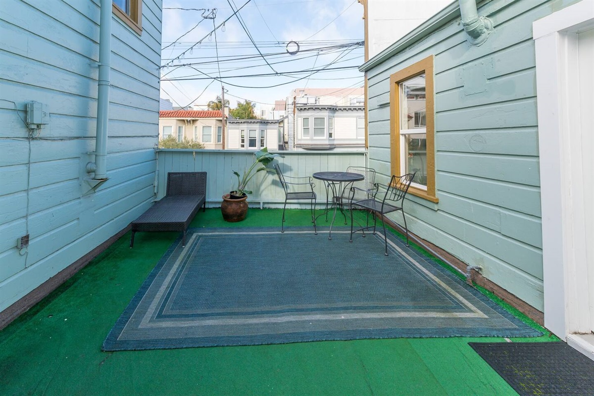 Shared patio space with the studio apartment