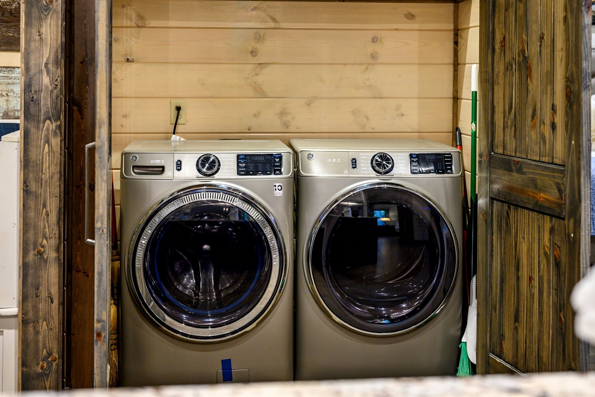 High capacity washer and dryer tucked away conveniently out of view behind 2 doors in the kitchen/living area