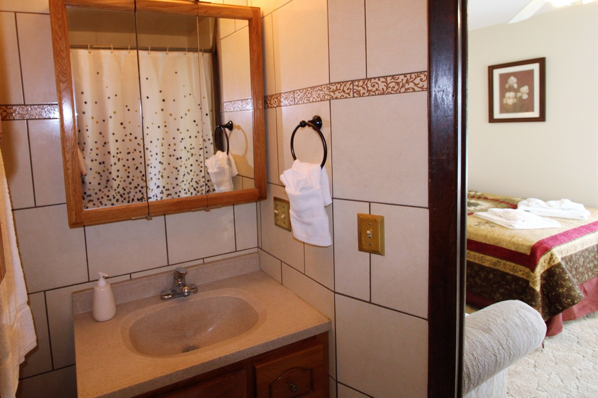 Modern amenities in a fully tiled bathroom