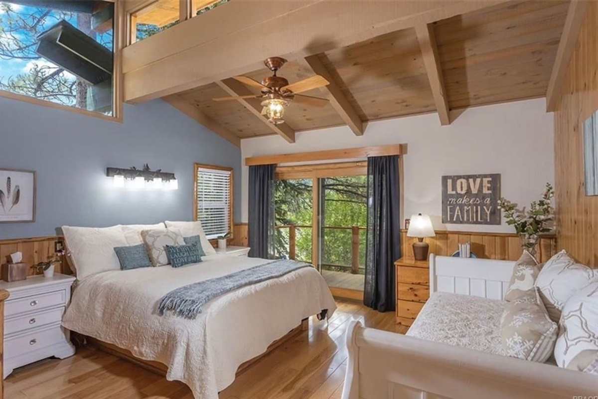 Bedroom #3: It has 1 queen bed with deck access, bright windows, ceiling fan, and ensuite bathroom.