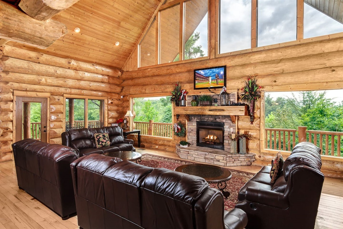 Lots of space in main living room for everyone to gather around the fireplace