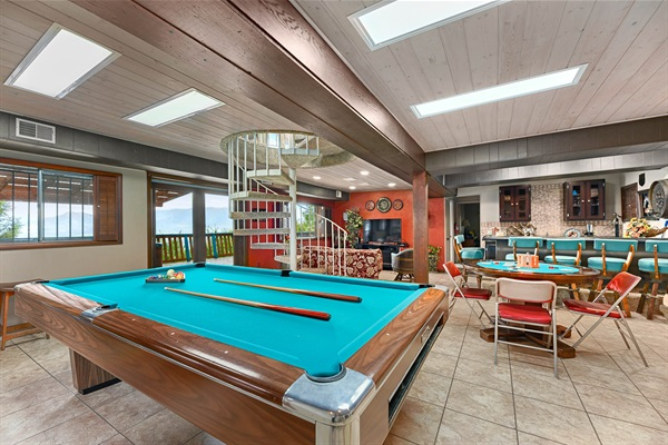 Lower level includes pool table, poker table, bar and entertainment lounge