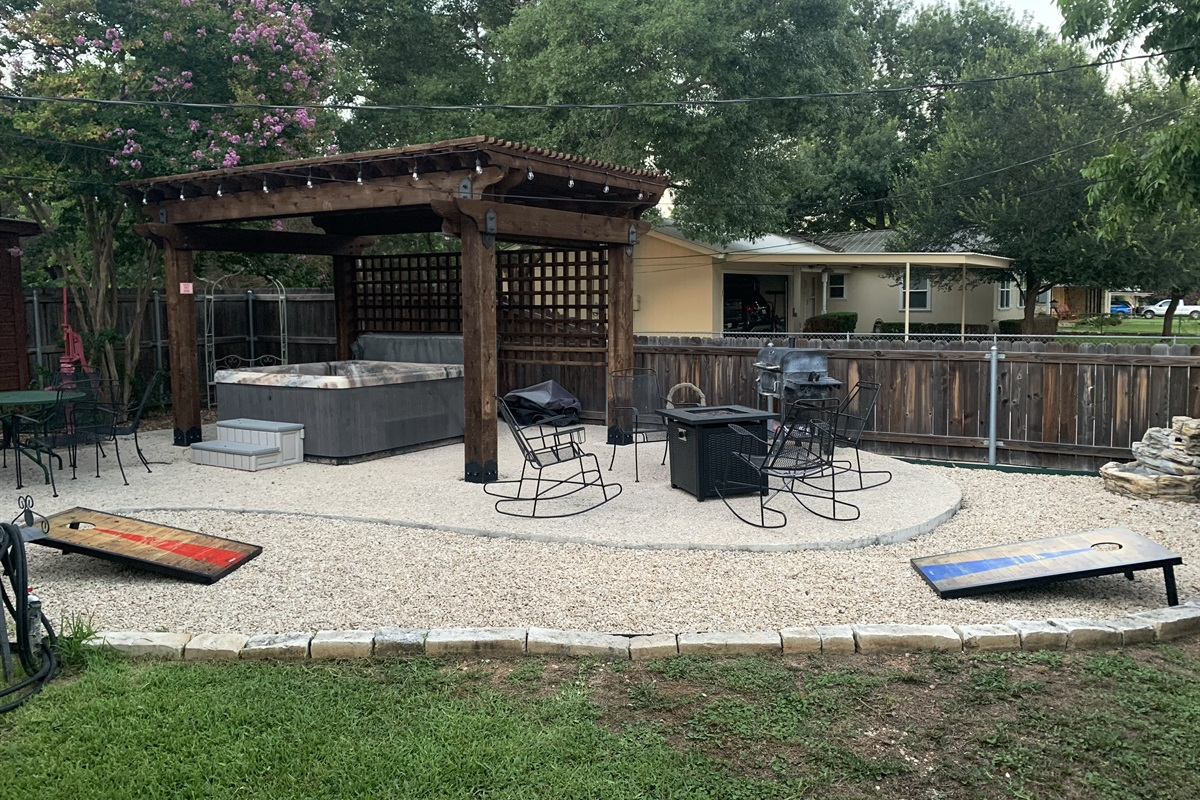 Outdoor area of Musik Haus - hot tub, fire pit, grill, and games!