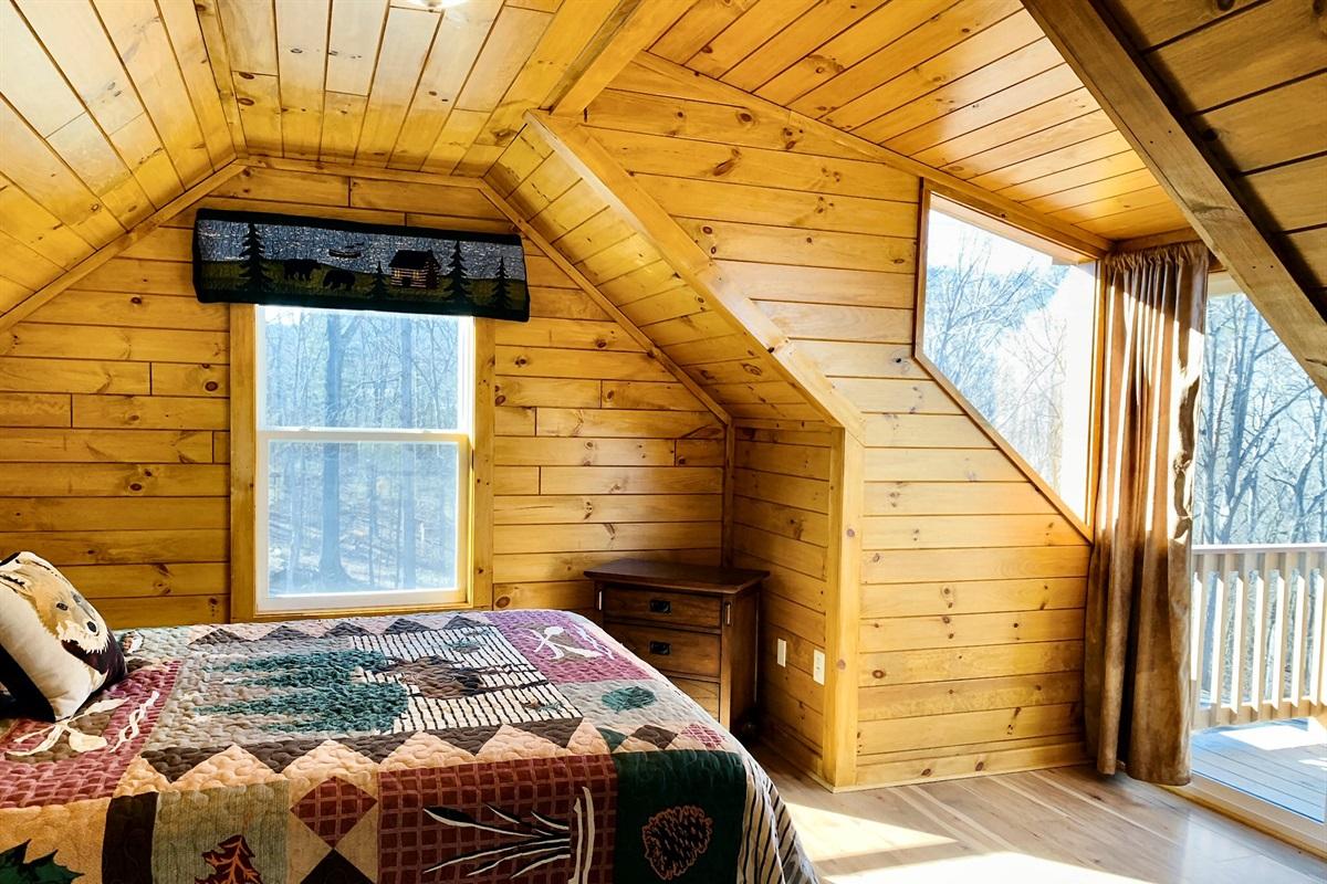 Upstairs bedroom has private deck with sliding door
