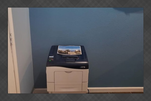 Laser printer for guests to print a favorite sunset photo & place in guest book