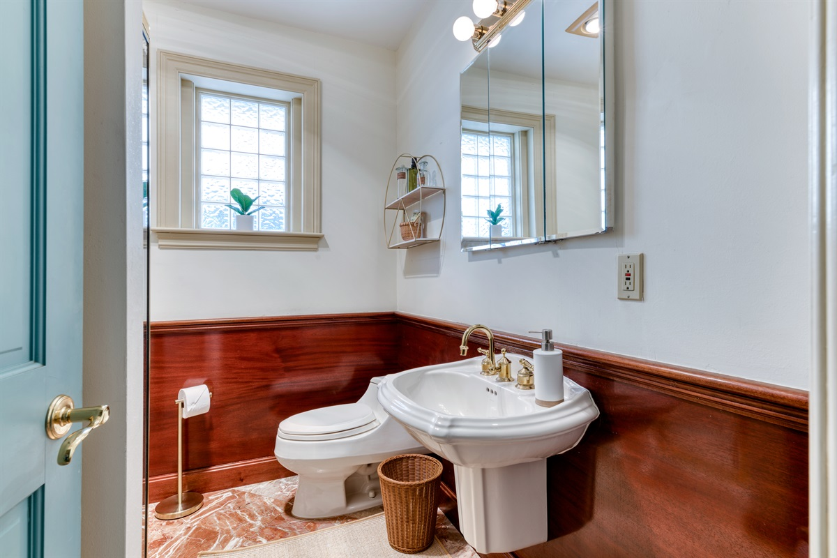 Elegant, yet old school. This bathroom has unique features. Shower and gold fixtures throughout with rich wood tones. Behind the door is an upright washer/ dryer. We supply all the towels, linens and cleaning supplies you need.