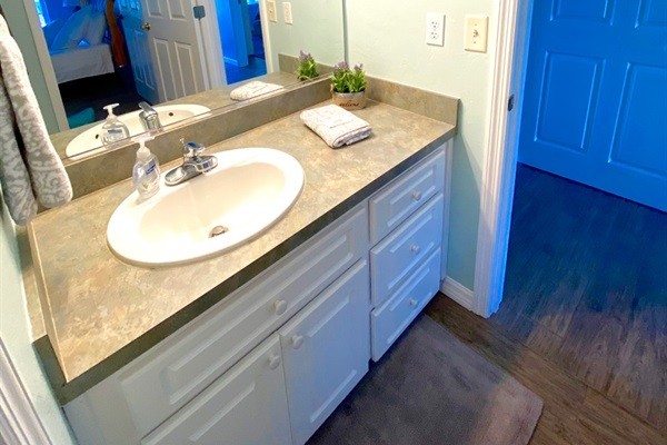Hall bath serves guests and second bedroom