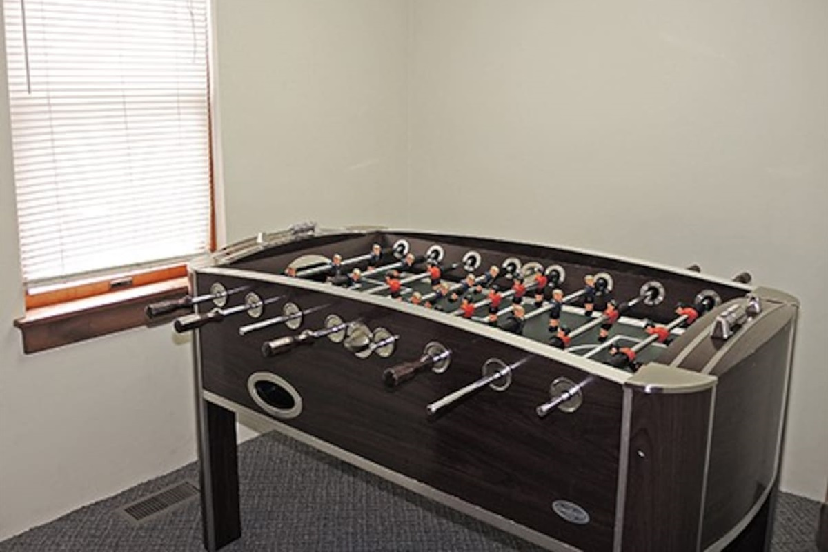 A game room in each unit with foosball table