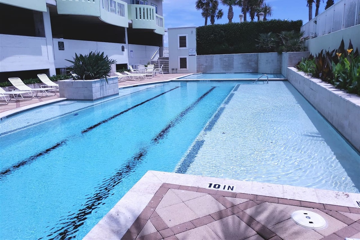 Lap pool with lounge chairs