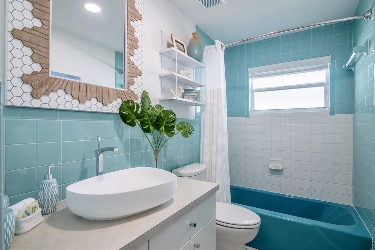 Bathroom has restored 1960's vintage aqua blue tiles.