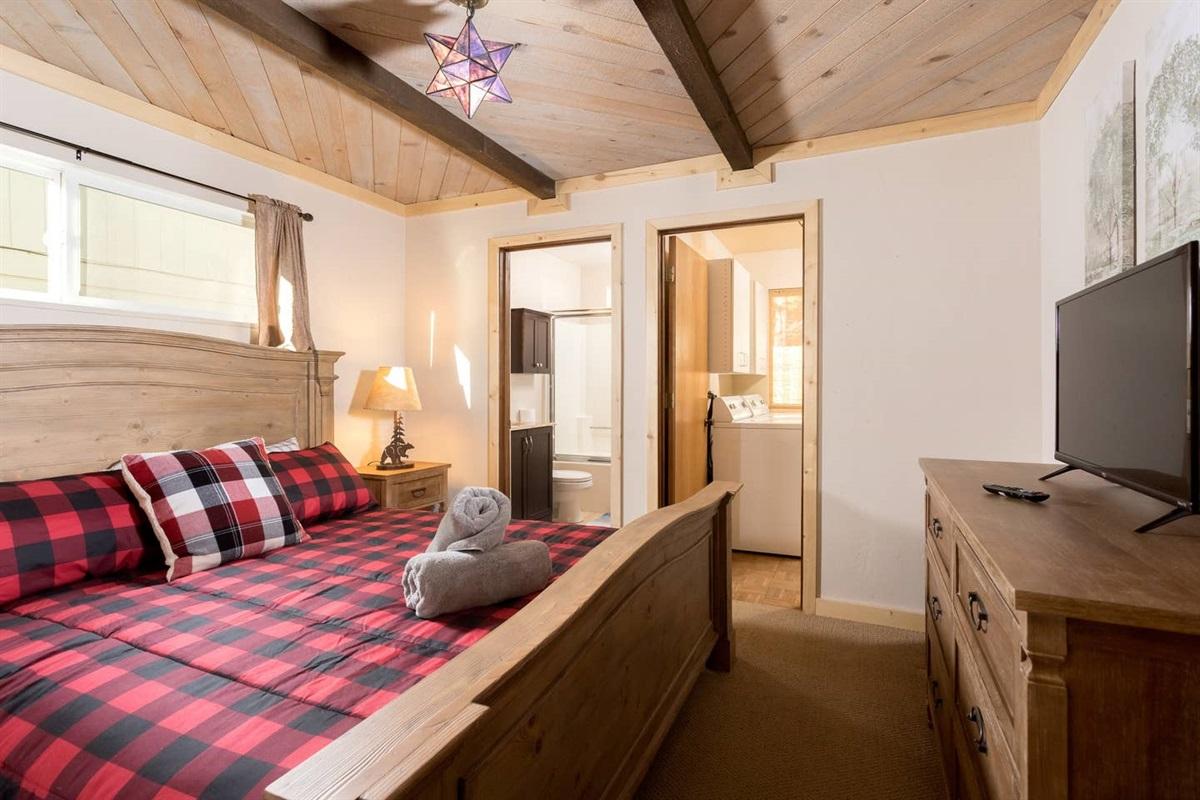 Bedroom #1: Master bedroom with 1 king bed, dresser, TV with Roku, closet, & en-suite bathroom.