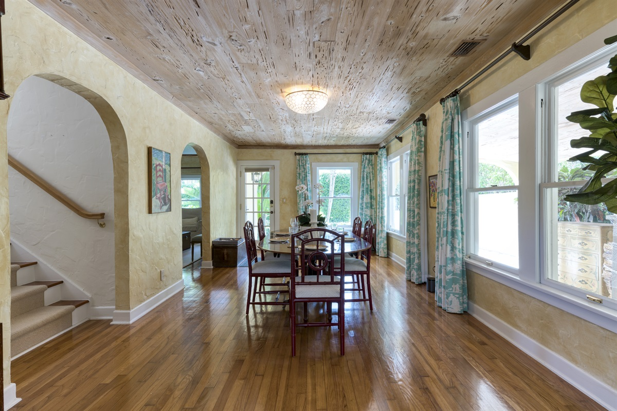 Welcome to the main house. Large Dining Room table for 6 under unique wood designed ceiling and stunning French doors.  Staircase leads up to 2 bedrooms. 1 Twin and 1 kids room with a full daybed.