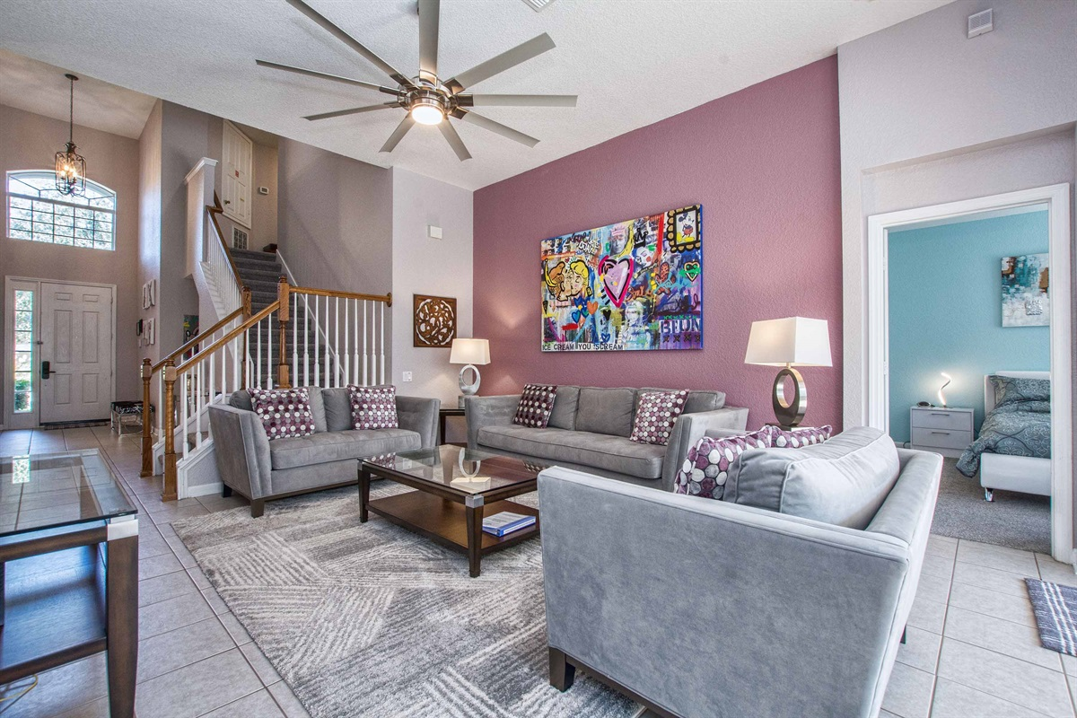 Living room with convenient access to both master bedroom suites.