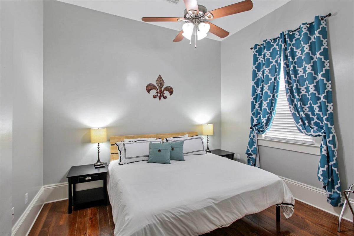 "Bedroom 4. 1 king bed. Closet. 39"" tv. Luggage rack."