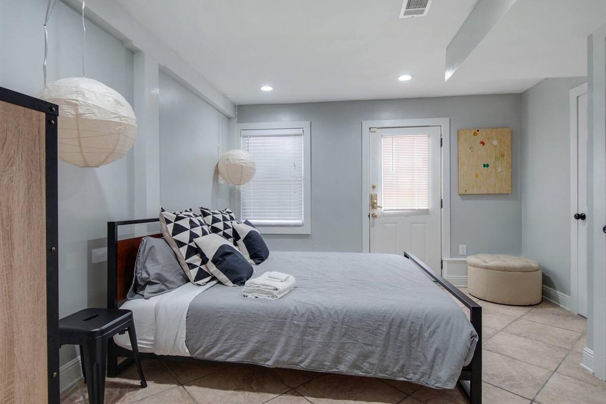 Bedroom 2.  King bed. En-suite bathroom. Exterior door.