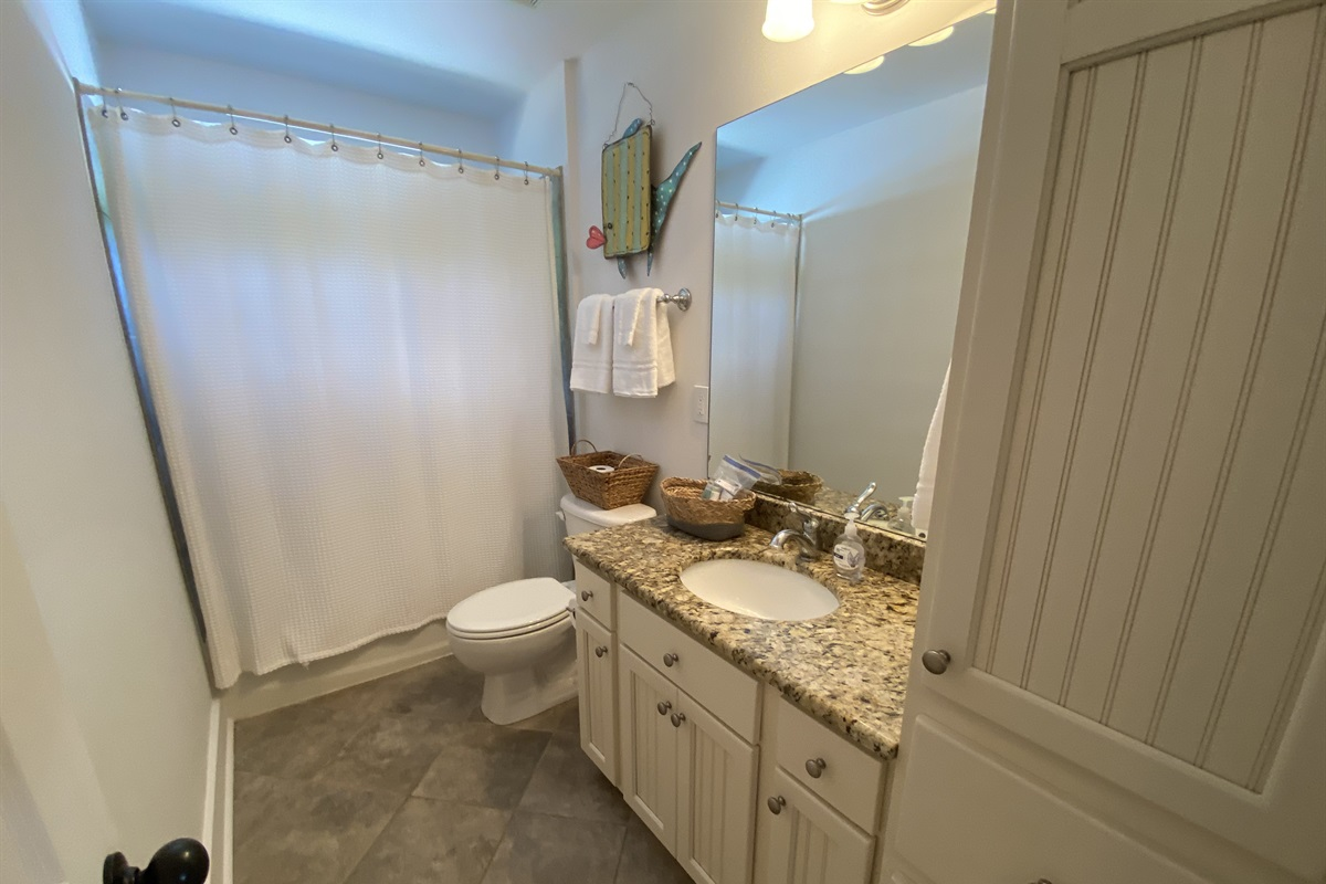 Guest bathroom stocked with white towels during your stay and black makeup cloths for removal of eye makeup.