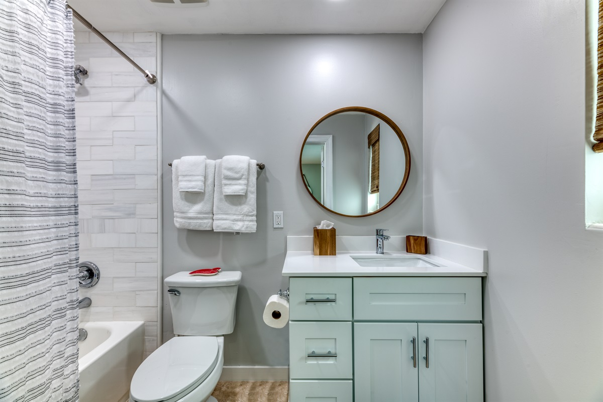 Master Bathroom with gorgeous wooden fixtures and shower/ tub combination