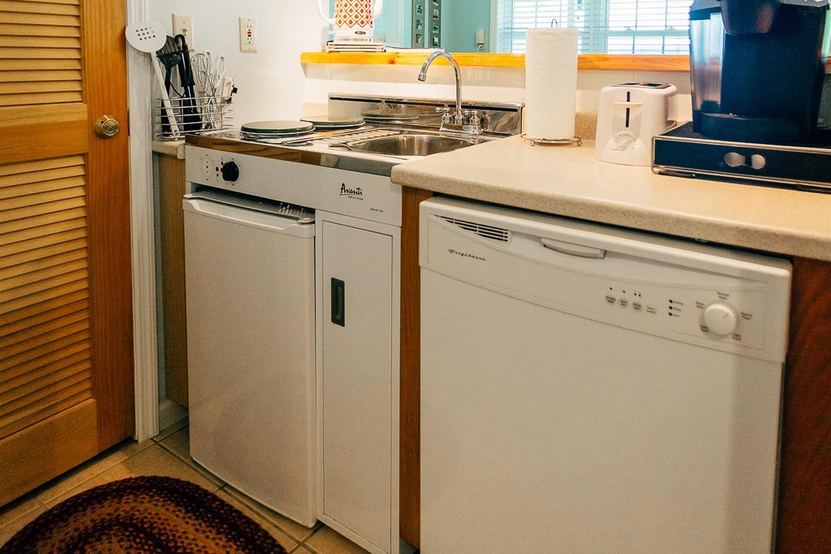 Kitchenette, dishwasher and mini fridge.