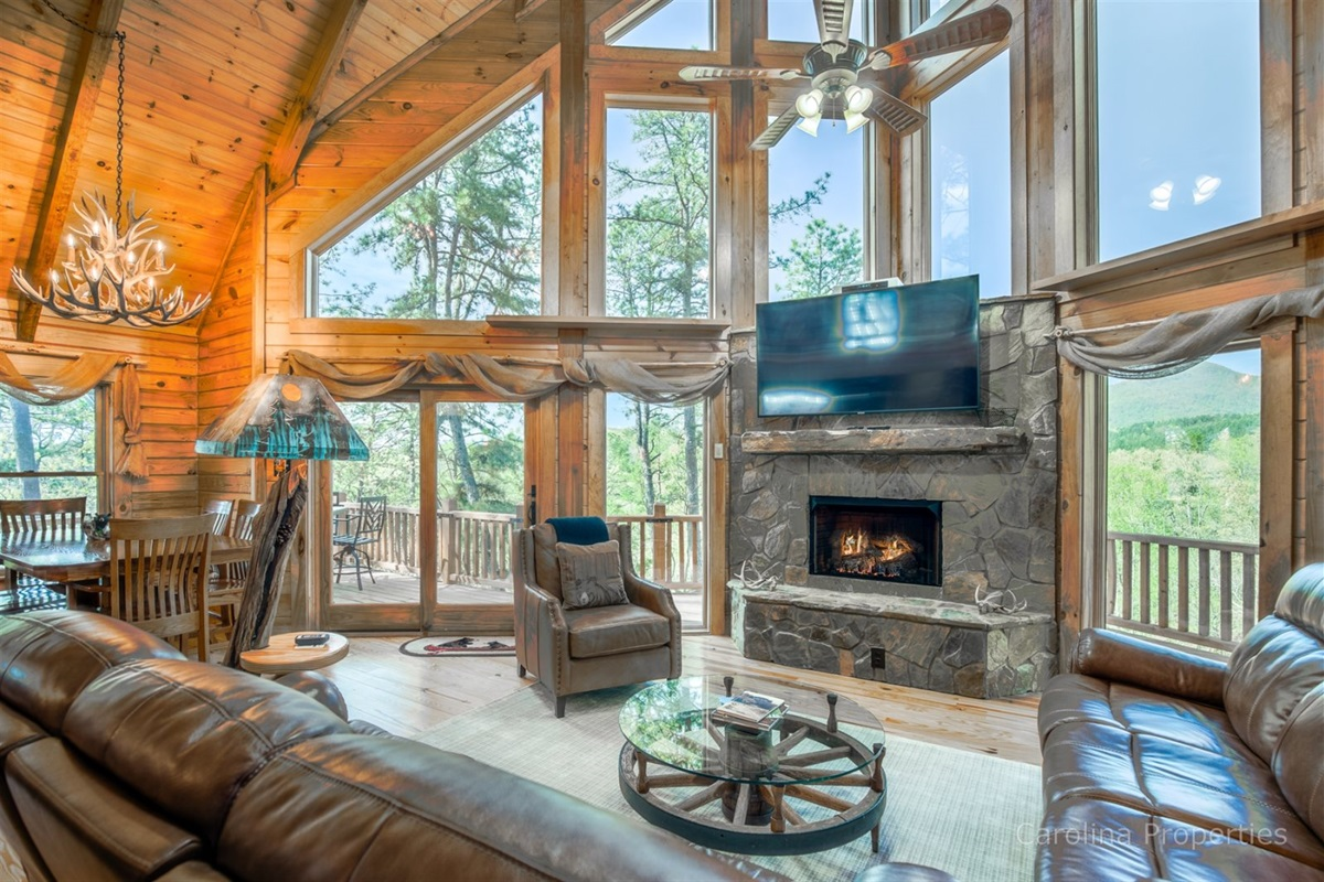 Main level living room with gas log fireplace and amazing view