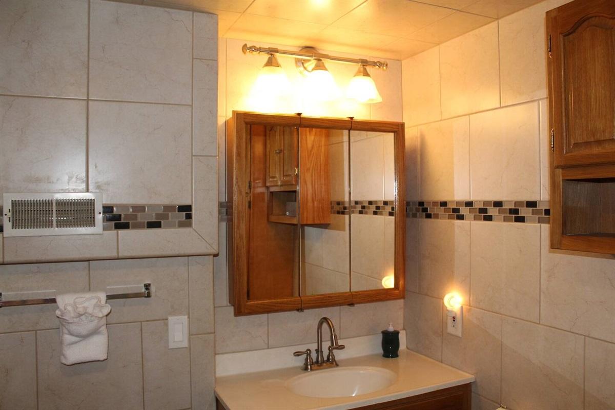Fully tiled modern bathroom