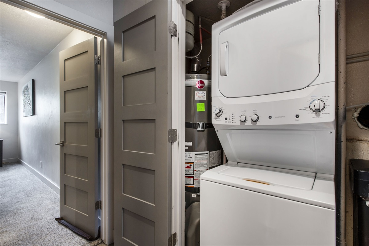 Washer and Dryer located between the king and queen suite downstairs.