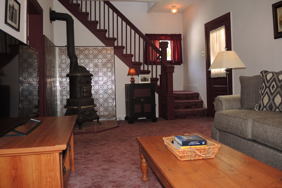 Living room with stairs to 2nd floor