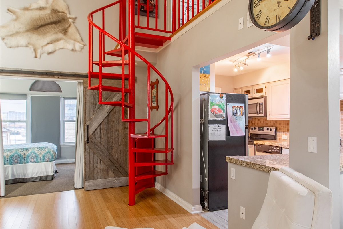 Who doesn't love a red spiral staircase?