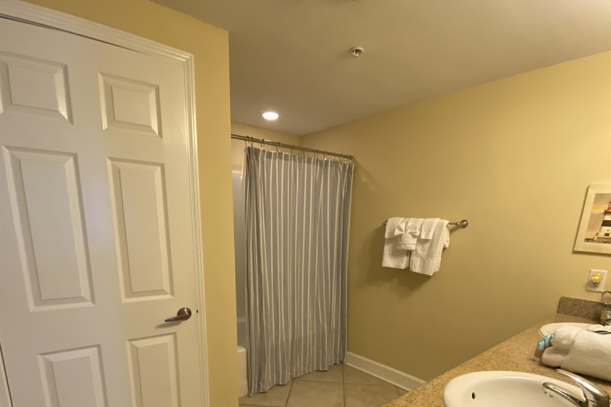Guest bath 2, tub shower combo and double vanities