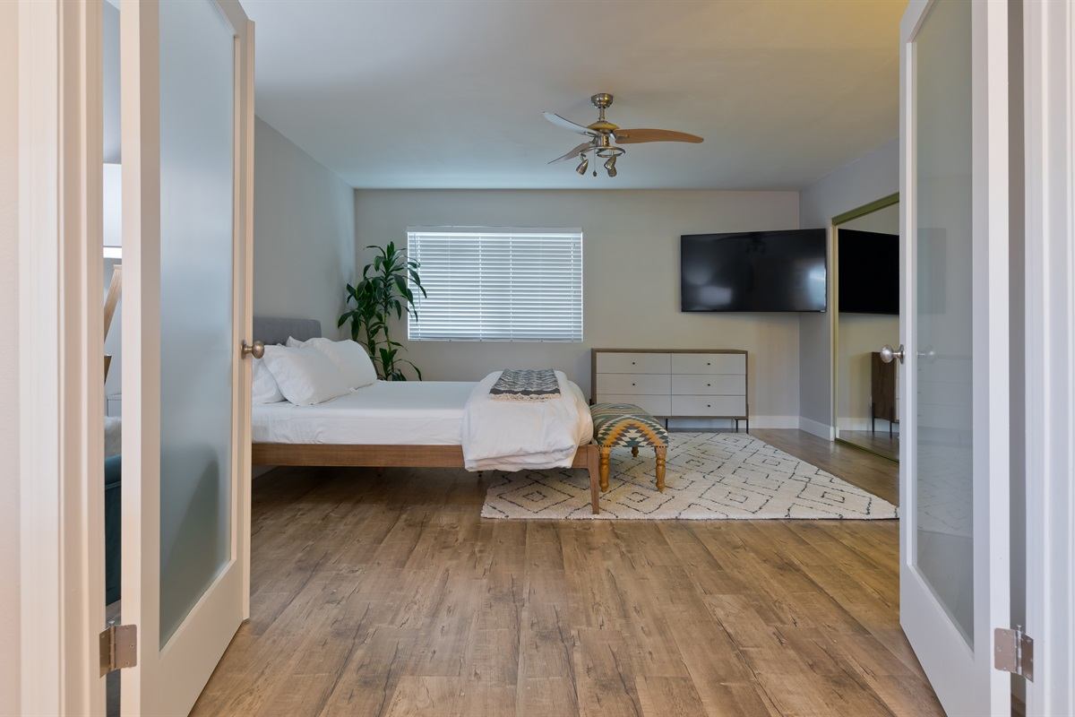 Double french doors reveal the Master Suite, directly adjacent to the dining room.
