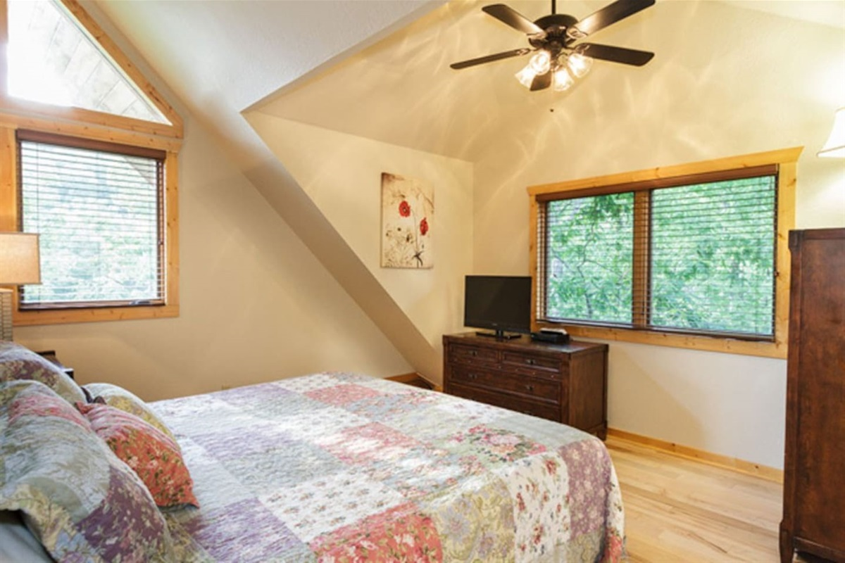 Upstairs King room with full bath outside door.