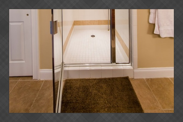 A huge walk-in shower is perfect after a long day at the beach.