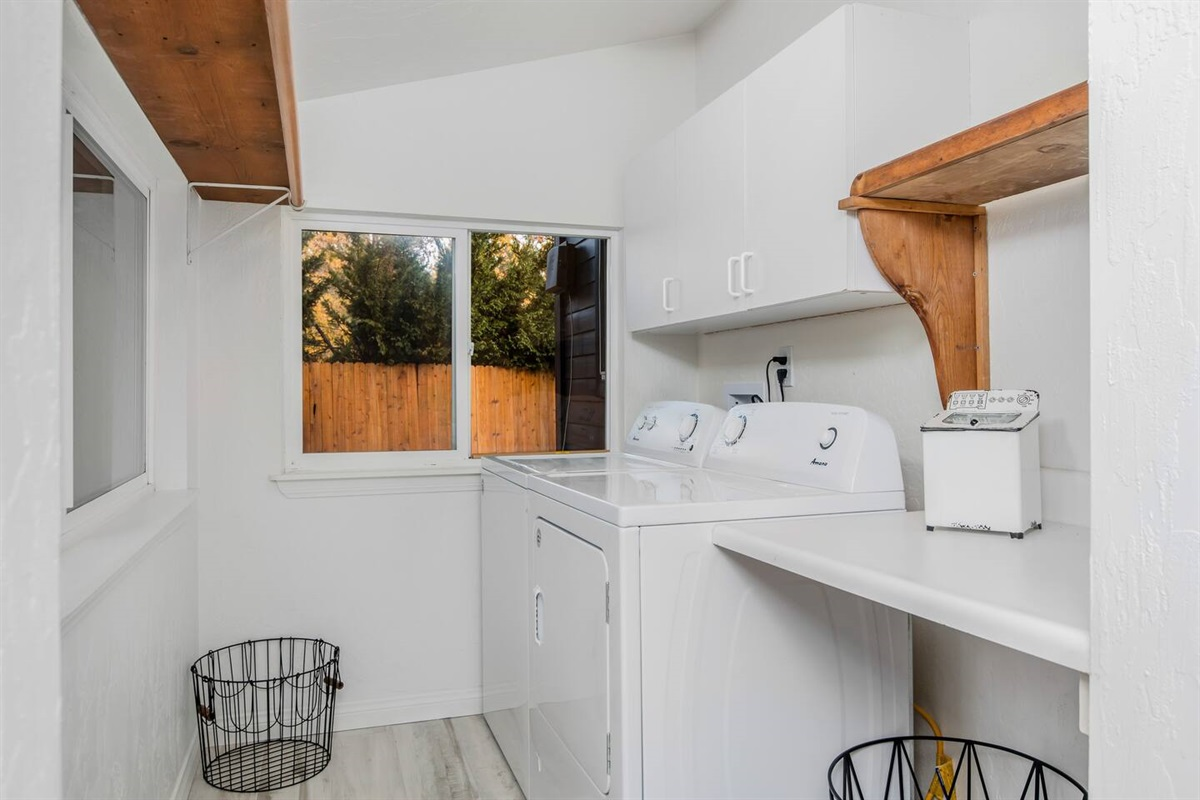 Mud Room & Laundry (Lower Level): Features an attached laundry area with full washer and dryer.