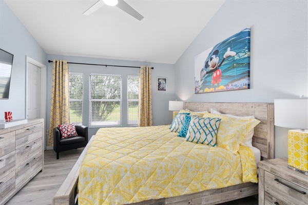 Spacious master suite colored with Disney! Enjoy the view with a great nights rest and large 55' Smart 4k TV!