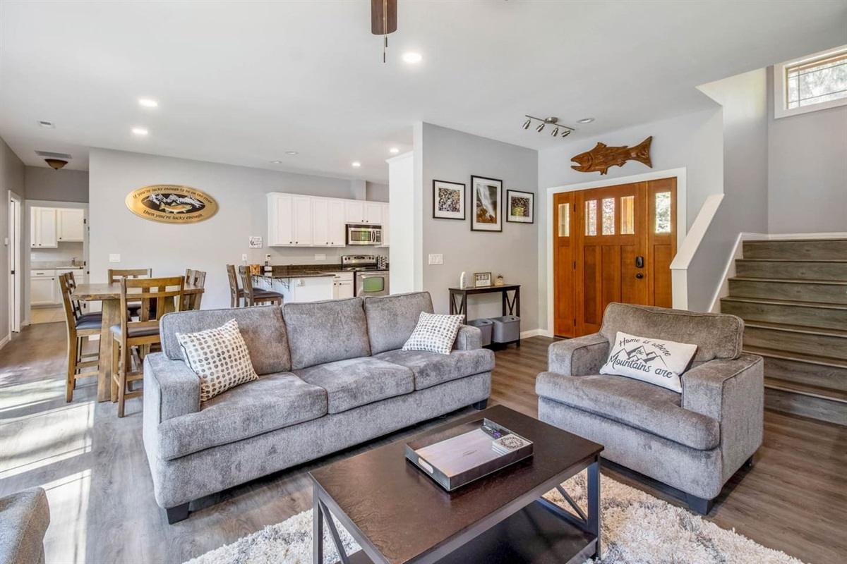 Open concept living and dining room with ample seating for your whole family.
