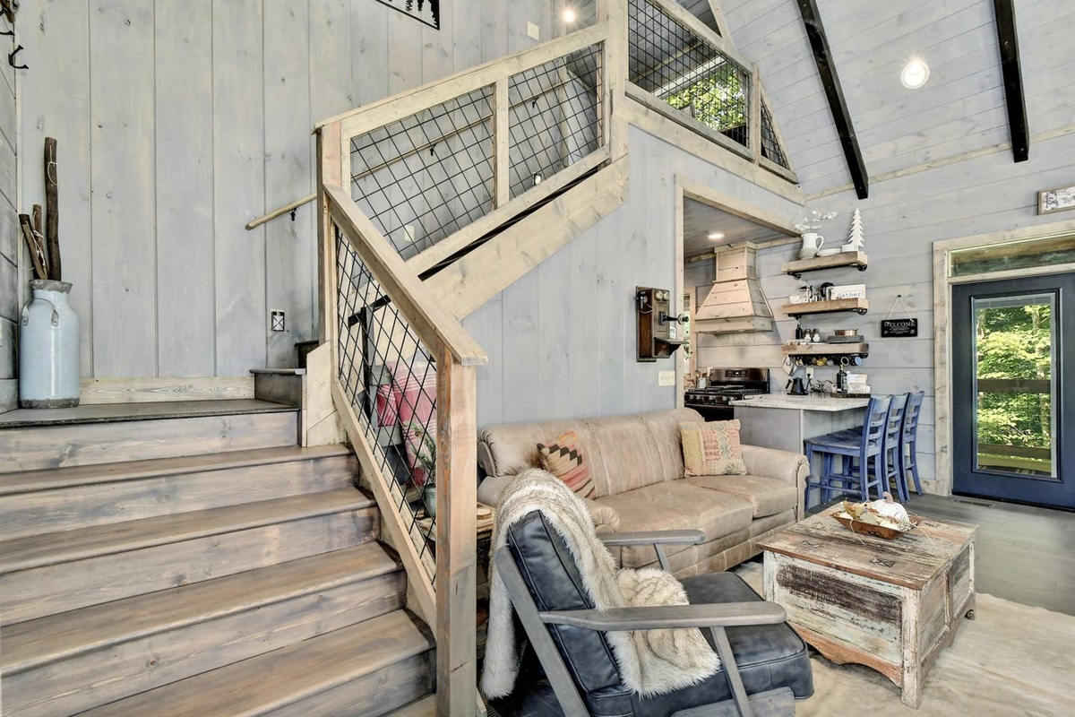 Retreat up the stairs to an open loft and private Fox Hole Master Suite