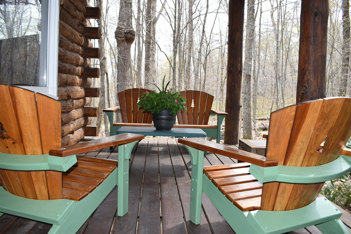 Classic Adirondack furniture on the front porch