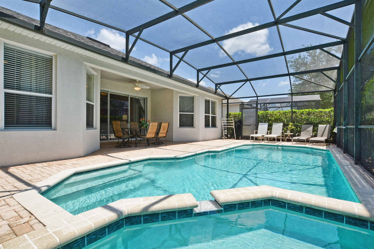 South facing saltwater pool with sun loungers.