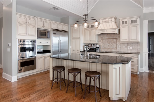 Prepare family meals in chef's kitchen with Viking appliances and a lake view
