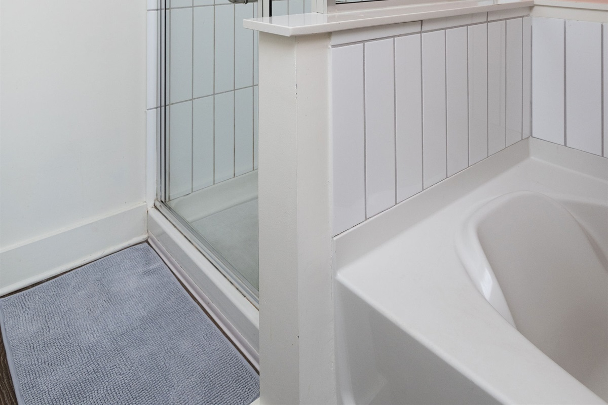 Standing shower and soaking tub in ensuite bathroom!