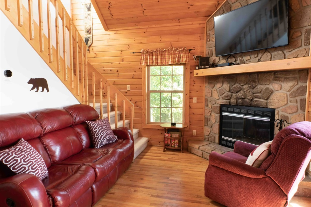 Cozy living room with gas fireplace and smart TV