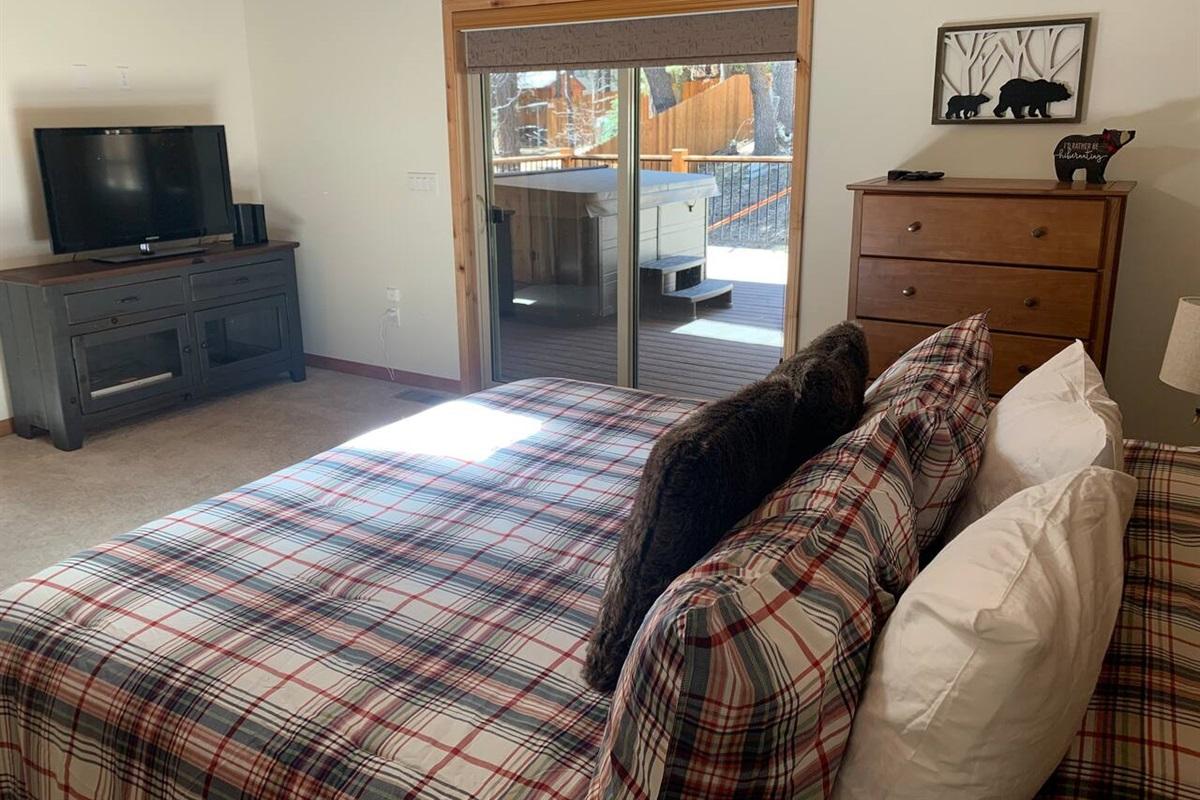 Flat screen TV in master bedroom.