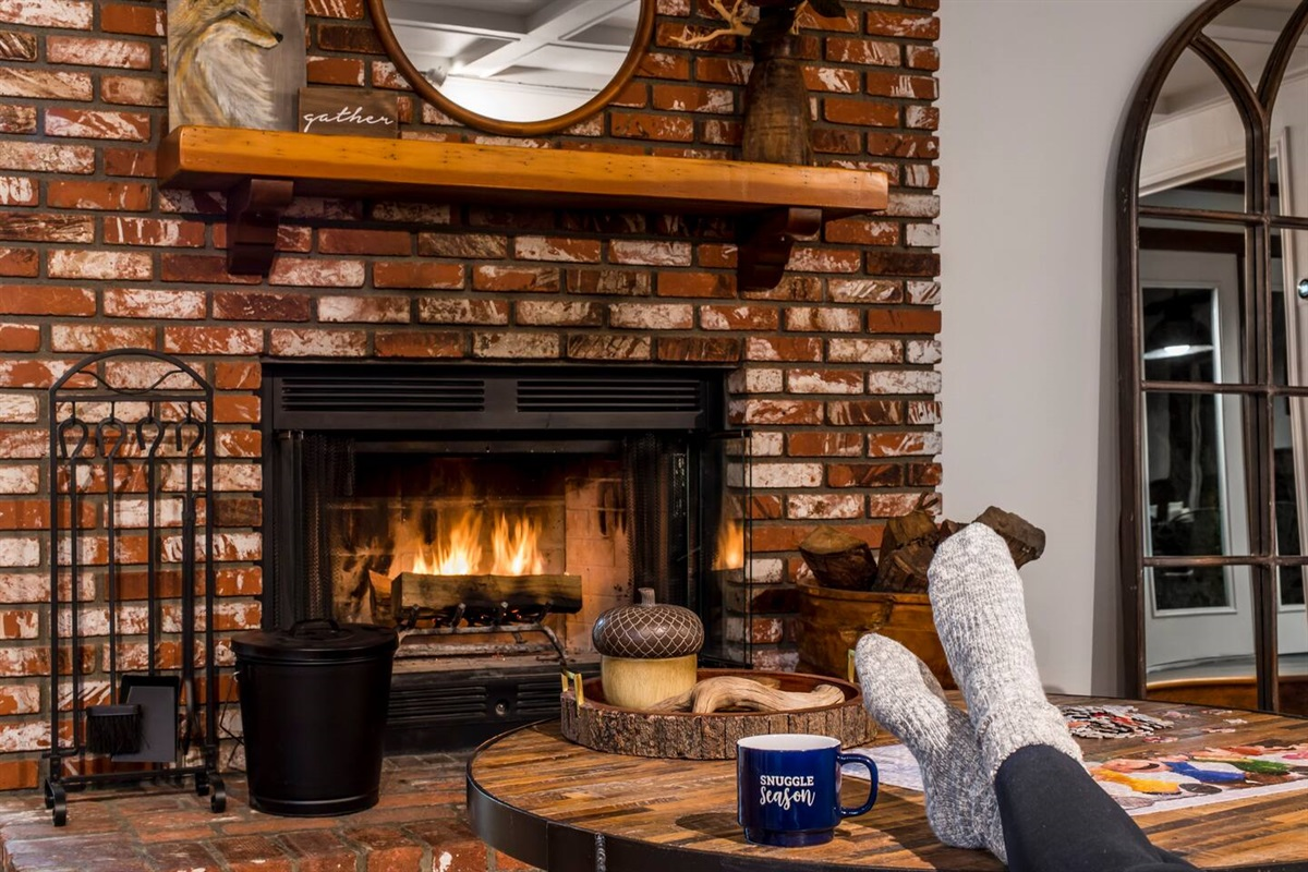 Living Room (Lower Level): Sip a cup of hot cocoa or a glass of wine by the wood burning brick fireplace after a long day of enjoying Big Bear!