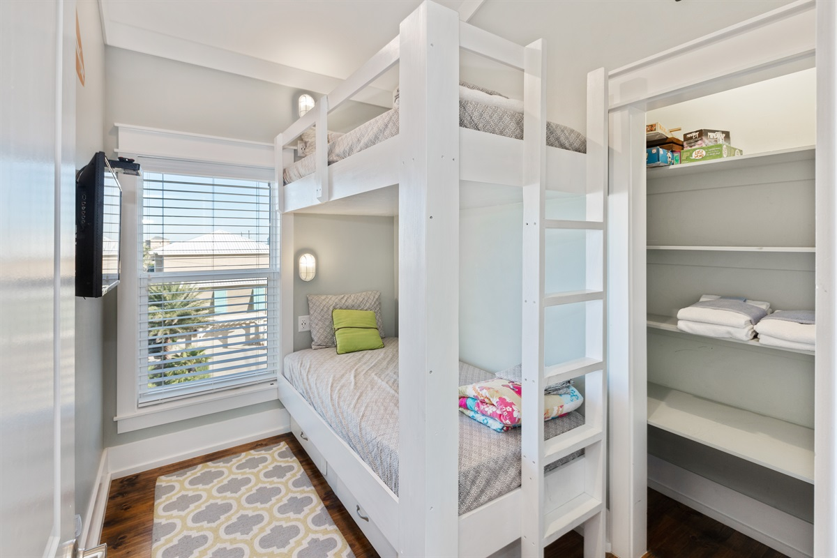 "This fun, beachy, kid-friendly bunk room on the 3rd floor is the perfect space for your kids to enjoy a ""sleepover"" with their friends, siblings or cousins in a space they can call their own."